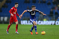 Joe Ralls of Cardiff city ® breaks away from Tom Lawrence of Blackburn Rovers. Skybet football league championship match, Cardiff city v Blackburn Rovers at the Cardiff city stadium in Cardiff, South Wales on Saturday 2nd Jan 2016.<br /> pic by Andrew Orchard, Andrew Orchard sports photography.