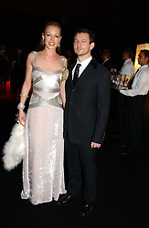 CAT DEELEY and her boyfriend at the Moet & Chandon Fashion Tribute 2005 to Matthew Williamson, held at Old Billingsgate, City of London on 16th February 2005.<br /><br />NON EXCLUSIVE - WORLD RIGHTS