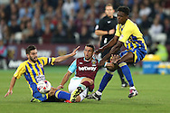 Jonathan Calleri of West Ham United is tackled by Seamus Conneely of Accrington Stanley (l) and Omar Beckles of Accrington Stanley (r). EFL Cup, 3rd round match, West Ham Utd v Accrington Stanley at the London Stadium, Queen Elizabeth Olympic Park in London on Wednesday 21st September 2016.<br /> pic by John Patrick Fletcher, Andrew Orchard sports photography.