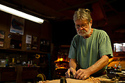 Senior man working in his wood workshop.