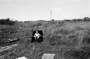 A boy sits on a disused sofa on a patch of waste ground that is used as a dump on the Northwood Estate in Kirkby, Merseyside, a notoriously run down inner city area