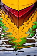Reflections of colorful tour boats on Ilha do Mel (Honey Island), Brazil, South America