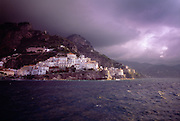 The sky turns dark as a storm approaches Positano on the Amalfi Coast of Italy