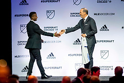 January 11, 2019 - Chicago, IL, U.S. - CHICAGO, IL - JANUARY 11: Siad Haji greets MLS commissioner Don Garber after being selected as the number two overall pick to the San Jose Earthquakes in the first round of the MLS SuperDraft on January 11, 2019, at McCormick Place in Chicago, IL. (Photo by Patrick Gorski/Icon Sportswire) (Credit Image: © Patrick Gorski/Icon SMI via ZUMA Press)