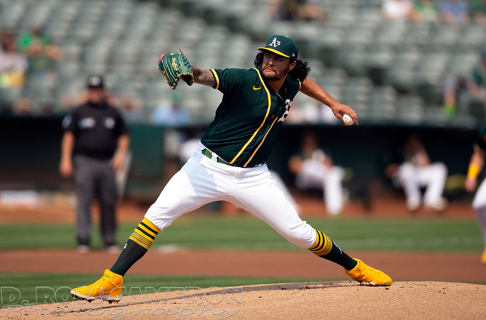 Sep 25, 2021; Oakland, California, USA; Oakland Athletics starting pitcher Sean Manaea (55) delivers against the Houston Astros during the first inning at RingCentral Coliseum. Mandatory Credit: D. Ross Cameron-USA TODAY Sports
