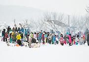 Large group of children playing in snow, Nagano, Japan