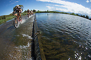 Bobby Behan of Team Meerendal Songo Specialized crosses the Breede River during stage 2 of the 2014 Absa Cape Epic Mountain Bike stage race from Arabella Wines in Robertson, South Africa on the 25 March 2014<br /> <br /> Photo by Greg Beadle/Cape Epic/SPORTZPICS
