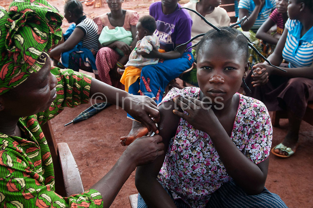 Central African Republic. August 2012. Batalimo camp for refugees from the Democratic Republic of Congo. Woman being vaccinated