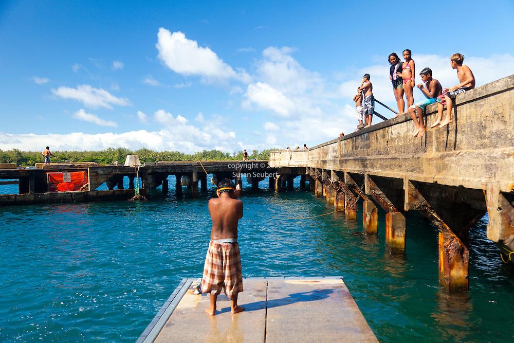Maui, Hawaii. Families enjoying a sunny, Sunday afternoon in Hana Bay, Maui.
