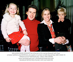MR & MRS MARK STEWART he is the son of Sir Jackie Stewart with their children LEONA and MARCUS, at a party in London on 8th December 2001.	OWD 70