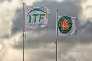 Roland Garros and ITF flags over the rooftop of Philippe Chatrier stadium during the Roland Garros 2020, Grand Slam tennis tournament, on October 5, 2020 at Roland Garros stadium in Paris, France - Photo Stephane Allaman / ProSportsImages / DPPI