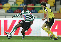 """PORTUGAL - AVEIRO 21 NOVEMBER 2004: (L to R) DOUALA #17 and RIBEIRO #25 in the 11¼ leg of the Super Liga, season 2004/2005, match  SC Beira Mar vs Sporting CP (2-2), held in """"Mario Duarte"""" stadium,  21/11/2004  01:30:23<br />(PHOTO BY: NUNO ALEGRIA/AFCD)<br /><br />PORTUGAL OUT, PARTNER COUNTRY ONLY, ARCHIVE OUT, EDITORIAL USE ONLY, CREDIT LINE IS MANDATORY AFCD-PHOTO AGENCY 2004 © ALL RIGHTS RESERVED"""