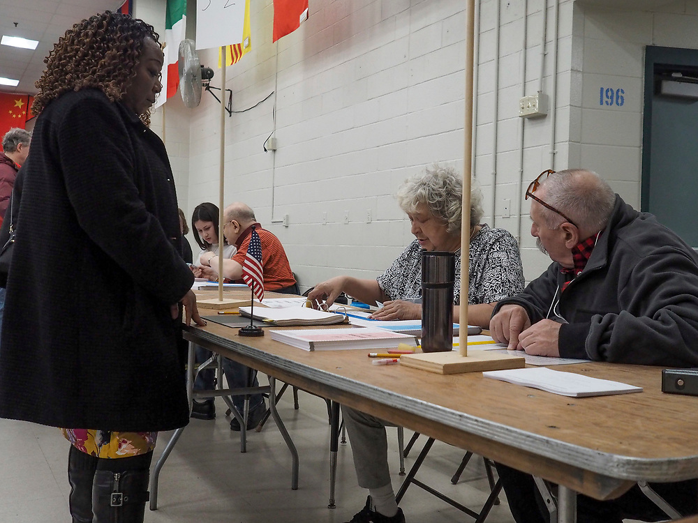 Voting officials check in voters in Nashua, New Hampshire's Ward 8.