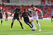 Doncaster Rovers forward John Marquis (9) under attack from Portsmouth FC defender Anton Walkes (2) and Portsmouth FC midfielder Jamal Lowe (10) during the EFL Sky Bet League 1 match between Doncaster Rovers and Portsmouth at the Keepmoat Stadium, Doncaster, England on 25 August 2018.Photo by Ian Lyall.
