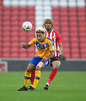 Football - 2020 / 2021 FA Cup - Round One - Sunderland vs Mansfield Town - Stadium of Light<br /> <br /> Kellan Gordon of Mansfield Town vies with Josh Scowen of Sunderland<br /> <br /> <br /> COLORSPORT/BRUCE WHITE