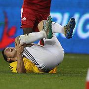 James Rodríguez, Colombia, reels from a hard tackle during the Columbia Vs Canada friendly international football match at Red Bull Arena, Harrison, New Jersey. USA. 14th October 2014. Photo Tim Clayton