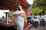 Maha Faraigon, organiser of the first-ever international Conference on Womens' Challenge in Darfur, leaves a trostrum after giving a speech in front of several hundred local Darfuri women. They gathered outside a compound belonging to the Govenor of North Darfur in Al Fasher (also spelled, Al-Fashir) where the women from remote parts of Sudan gathered to discuss peace and political issues.