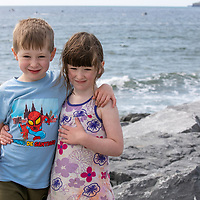 Siblings Sean and Eilis Casner from Ennis watching the Annual Pat Conway and friends Charity Swim from Lahinch to Liscannor Pier in aid of the Burren Chernobyl Project