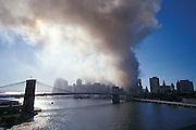 September 11 2001. downtown Manhattan after both World Trade Center towers have collapsed. Brooklyn Bridge in the foreground.