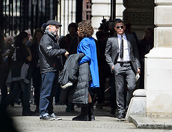 "© Licensed to London News Pictures. 30/05/2015. London, UK. . Filming for the new James Bond film ""Spector"" with Daniel Craig (pictured right), Naomie Harris (pictured centre) and Sam Medez (left)at the courtyard of the UK Government Treasury building in Westminster, London . Photo credit: Ben Cawthra/LNP"