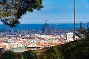 View of Sagrada Familia from Parc Guell, Barcelona, Catalonia, Spain. A public park design by famed Catalan architect Antoni Gaudi featuring gardens and architectural curiosities