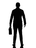one caucasian business man rear view back in silhouette on white background