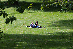 Green Park, London, June 6th 2016. A couple soak up the sun in Green Park as London basks in glorious summer sunshine with highs of 24º expected.