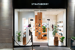 Exterior of new Strathberry shop selling designer handbags on Multrees Walk, Edinburgh, Scotland, UK