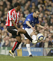 Photo: Aidan Ellis.<br /> Everton v Sunderland. The Barclays Premiership. 01/04/2006.<br /> Sunderland's Justin Hoyte tries to block a pass from everton's Leon osman