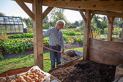 Charles Dowding with his compost heaps