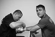 Drew Dober has his hands wrapped before his fight against Efrain Escudero during UFC 188 at the Mexico City Arena in Mexico City, Mexico on June 13, 2015. (Cooper Neill)