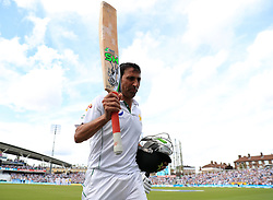 Pakistan's Younis Kahn walks off after getting out during day three of the Fourth Investec Test match at The Kia Oval, London.