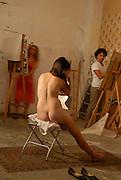 Art class. Female nude model modelling for artists