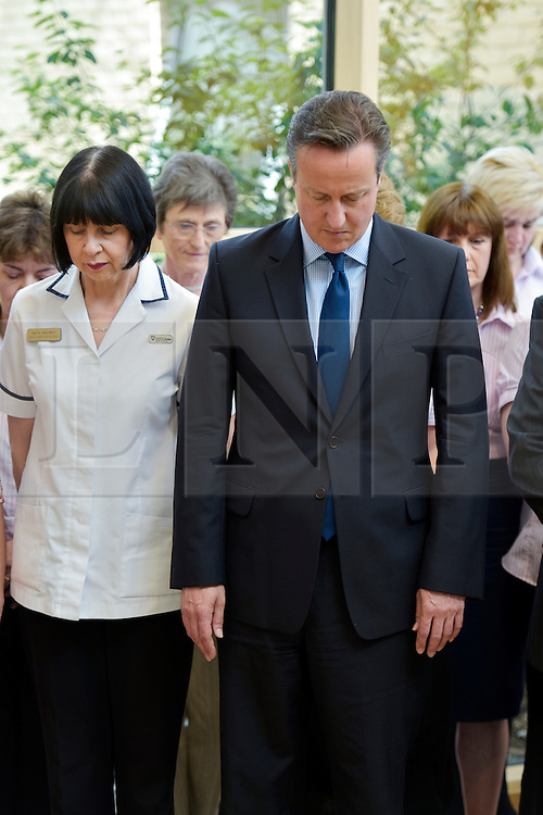 © Licensed to London News Pictures. 03/07/2015. Chipping Norton, Oxfordshire. Prime Minister DAVID CAMERON observes the UK wide minute silence in memory of the victims of the Tunisia IS killing of tourists in the seaside town of Sousse. Mr Cameron is opening the new Health Centre at Chipping Norton.<br /> HEMSWORTH/LNP