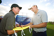 January 6 2016: Jordan Spieth signs autographs after his Pro-Am round Final Round of the Hyundai Tournament of Champions at Kapalua Plantation Course on Maui, HI. (Photo by Aric Becker)