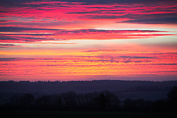 © Licensed to London News Pictures. 05/03/2014. Alton, Hampshire, UK. A bright pink and orange sky visible near Alton in Hampshire during sunset, today 5th February 2014. Photo credit : Rob Arnold/LNP