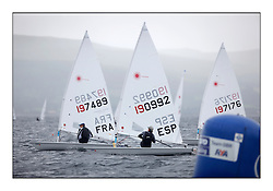 The second day of racing at the World Laser Radial Youth Championships, Largs, Scotland...Hilaric Baude FRA 197489 and Martin Guillermo Flores ESP 190992..317 Youth Sailors from 42 different nations compete in the World and European Laser Radial Youth Champiponship from the 17-25 July 2010...The Laser Radial World Championships take place every year. This is the first time they have been held in Scotland and are part of the initiaitve to bring key world class events to Britain in the lead up to the 2012 Olympic Games. ..The Laser is the world's most popular singlehanded sailing dinghy and is sailed and raced worldwide. ..Further media information from .laserworlds@gmail.com.event press officer mobile +44 7866 571932 and +44 1475 675129 .