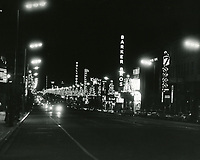 1964 Looking east on Hollywood Blvd. from Orchid Ave. near Seven Seas Restaurant at night