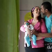 Giusy and Vinod - Gordola, Switzerland, October 2015.<br /> Giusy, Vinod together with their son Isaac, 40 days old. Giusy 28, Swiss-Italian origins, discovered that she was affected by multiple sclerosis in 2011. Her partner, Vinod, 32, was born in Switzerland of Indian parents from Kerala. Giusy and Vinod met in 2012 and married in 2014. The devoted support of her partner has been essential for Giusy in this delicate time. For them, the disease it has never been an obstacle to the desire of having a child. Giusy and Vinod wish to other couples in similar situations to have the same strength.<br /> Giusy e Vinod (Gordola, Svizzera, Ottobre 2015. Giusy e Vinod insieme al loro figlio Isaac, 40 giorni. Giusy, 28 anni, ticinese di origini italiane, ha scoperto di essere affetta da sclerosi multipla nel 2011. Il suo compagno, Vinod, 32 anni, è nato in Svizzera da genitori indiani del Kerala. Giusy e Vinod si sono conosciuti nel 2012 e sposati nel 2014. L'appoggio sereno e premuroso di Vinod è stato fondamentale per Giusy in questo periodo di cambiamento. La malattia non è mai stata per loro un freno alla volontà di avere un figlio. Ad altre coppie in situazioni simili augurano di avere la loro stessa forza.