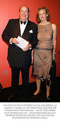 The HON.NICHOLAS SOAMES and his wife SERENA, at a party in London on 12th September 2002.PDE 258