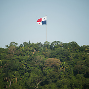 A large Panamanian flag flies atop Ancon Hill overlooking Panama City, Panama.