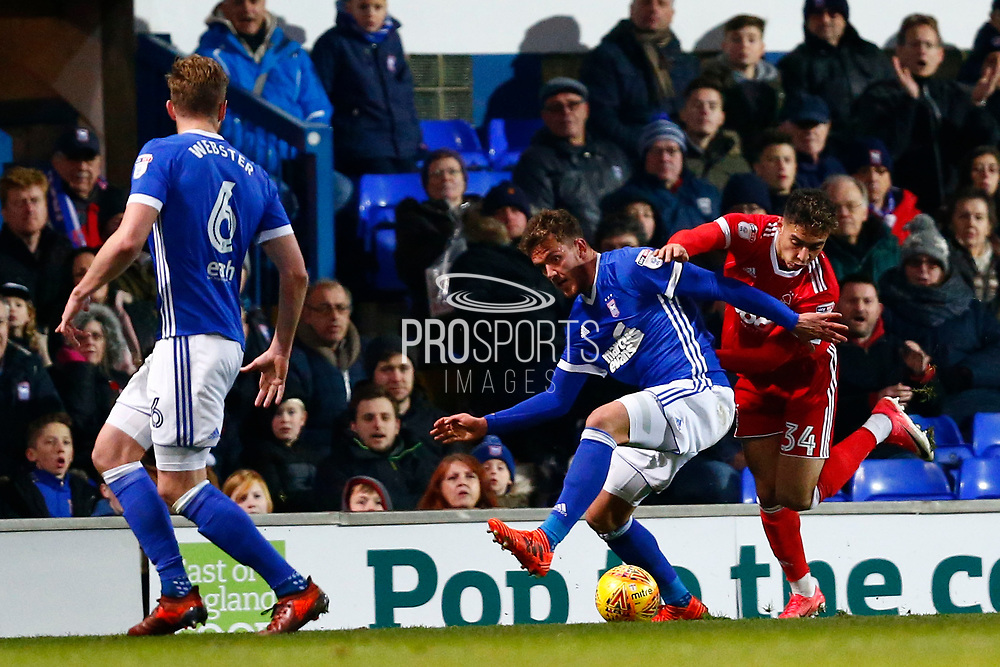 Nottingham Forest forward Tyler Walker (34) Ipswich Town midfielder Emyr Huws (44) battles for possession during the EFL Sky Bet Championship match between Ipswich Town and Nottingham Forest at Portman Road, Ipswich, England on 2 December 2017. Photo by Phil Chaplin.