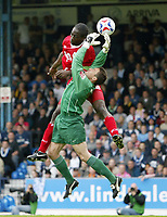 Photo: Chris Ratcliffe.<br />Southend United v Bristol City. Coca Cola League 1. 06/05/2006.<br />Mark McCammon (L) of Bristol City tries to get a header over keeper Darryl Flahavan of Southend United.