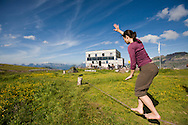 Guest practicing tightrope walking at hikers' hut in the Swiss Alps, Flumserberg, Sarganserland, Switzerland