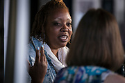 """Chef Nyanyika Banda responds to a question during the """"Corner Table Podcast"""" recording at Old Sugar Distillery in Madison, Wisconsin, Tuesday, June 18, 2019."""