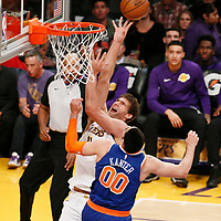 21 January 2018: Los Angeles Lakers center Brook Lopez (11) goes for the layup over New York Knicks center Enes Kanter (00) during the LA Lakers 127-107 victory over the New York Knicks, at the Staples Center, Los Angeles, California, USA.