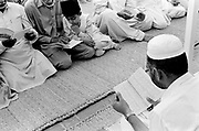 An imam leads his congregation. Also known as Qadiani's The Ahmadiyyas are the followers of Hazrat Mirza Ghulam Ahmad Qadiani (1835-1908). According to his followers, he was the  founder of the Ahmadiyya Muslim Jama'at and The Promised Messiah and Imam Mahdi. The Ahmadiyya (Qadiani) movement in Islam is a religious organisation with more than 30 million members worldwide. Ahmadiyyas are now banned from calling themselves Muslim in Pakistan and suffer terrible discrimination under anti-blasphemy laws and are regularly murdered for their faith.