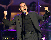 """Latin recording artist Marc Anthony performs his hit song """"You Sang To Me"""" October 26, 2000 during the taping of """"The American Red Cross Holiday Music Spectacular from Miami"""" at The Jackie Gleason Theater on Miami Beach. The show will be broadcast on the Fox network December 23, 2000. REUTERS/Colin Braley"""