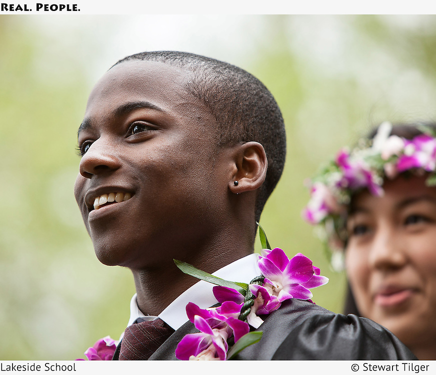 An African American high school student at graduation.
