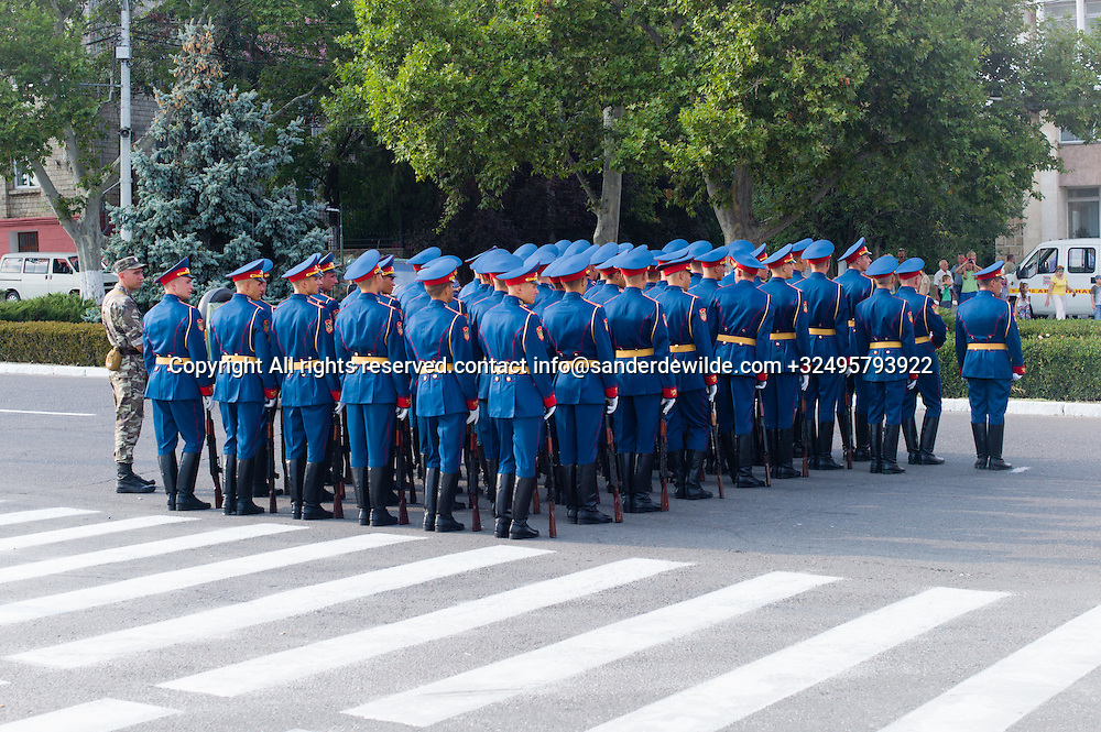 20150831 Moldova, Transnistria,Pridnestrovian Moldavian Republic (PMR) Tiraspol. Rehersal for the big parade, in the 25th  Transnistrian independance day when  they had a war separating from Moldova.a platoon in a strange blue color stand in a square awaiting orders.